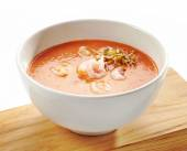 Bowl of tomato cream soup — Stock Photo