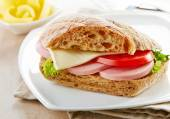 Sandwich with sausage and tomato — Stock Photo