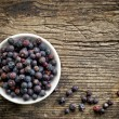Bowl of juniper berries — Stock Photo #59124453