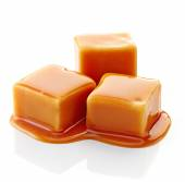 Caramel candies and caramel sauce — Stock Photo