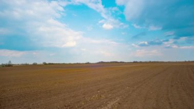 Spring plowed field, panoramic time-lapse — Stock Video