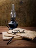 Still-life with old writing-books and an oil lamp — Stock Photo