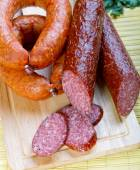 Smoked sausage ringlets and cut in the portions — Stock Photo