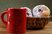 Red cup and fruitcakes in plates on a rural table — Photo