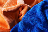 Dark blue and orange fabric with fibres a background — Stock Photo