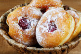 Donuts with jam in a wicker basket — Stock Photo