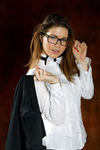 The girl with a tie-butterfly  and glasses — Stock Photo