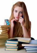 The girl with pile of books and writing-books on a white backgro — Stock Photo