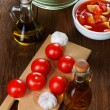 Still life with vegetables and a bottle of olive oil — Stock Photo #77500294
