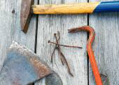 Claw hammer and rusty nails on the old boards — Stock Photo