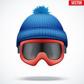 Knitted woolen blue cap with snow goggles. Winter seasonal sport hat. vector illustration — Stock Vector