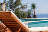Luxury swimming pool and deck chair — Stock Photo