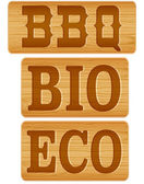 Nameplate of wood with words BBQ BIO ECO — Stock Vector