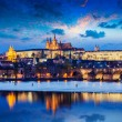 Charles Bridge and Prague Castle in twilight — Stock Photo #53050401
