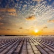 Wooden surface under sunset sky — Stock Photo #53886987