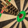 Three darts in bulls eye close up — Stock Photo #53988439