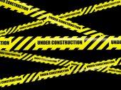 Yellow warning caution ribbon tape on black — Stock Photo