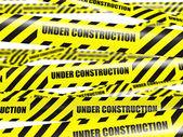 Yellow warning caution ribbon tape on white — Stock Photo