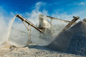 Industrial crusher - rock stone crushing machine — Stock Photo