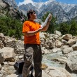 Hiker with map — Stock Photo #55799267