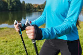 Closeup of womans hand with nordic walking poles — Stock Photo
