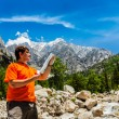 Hiker with map — Stock Photo #55861875
