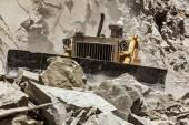 Bulldozer doing road construction in Himalayas — Stok fotoğraf