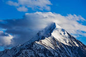 Snowcapped top of mountain in Himalayas — Stock Photo