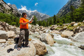 Hiker with map — Stock Photo