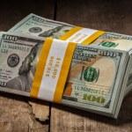 Stacks of new 100 US dollars 2013 banknotes — Stock Photo #57894683
