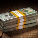 Stacks of new 100 US dollars 2013 banknotes — Stock Photo #57894703