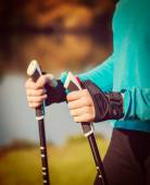 Womans hand holding nordic walking poles — Photo