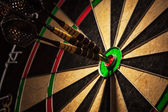 Three darts in bulls eye close up — Stock Photo