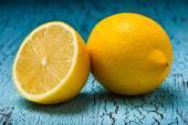 Lemon and cut half slice — Stock Photo