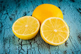 Lemon and cut half slices — Stock Photo