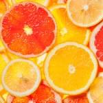 Colorful citrus fruit slices — Stock Photo #64183711