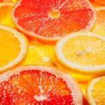 Colorful citrus fruit slices — Stock Photo #64662645