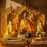 Buddha statues in Shwedagon pagoda — Stock Photo #66259043