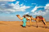 Cameleer camel driver with camels in dunes of Thar desert — Stock Photo
