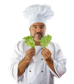 chief cook holding lettuce  — Stock Photo