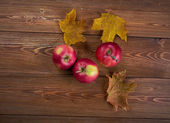 Autumn border from apples and fallen leaves  — Stock Photo