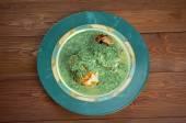 Merluza en salsa verde — Stock Photo