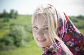 Portrait  beautiful girl in  kerchief  — Stock Photo