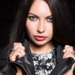 Woman posing in leather jacket — Stock Photo #72159401