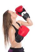 Woman kissing boxing glove — Stock Photo