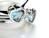 Rings with Blue topaz or aquamarine heart shape — Stock Photo