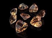 Heart shape yellow gemstones — Stock Photo