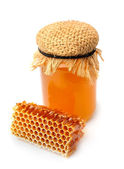 Honeycomb  and honey close up on a white background  — Stockfoto