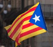 Catan flag in cityspace — Stock Photo