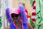 Unidentified man in plumage at Gay pride parade in Sitges — Stock Photo